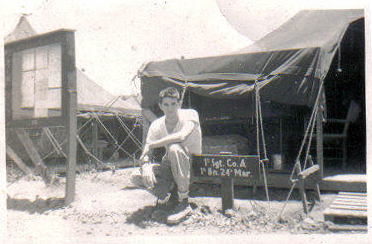Bill Davis outside the tent where he spent most of his time in camp.