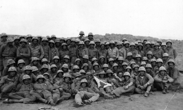 Members of the 24th Marines gather for a picture immediately after the battle of Iwo Jima.