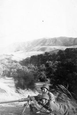 """25. ""Pinkey & me."" Pinkerton on the gun, Pope assistant gunner. 1943"