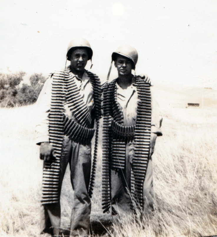 """""""Pinkie"""" - Melvin Pinkerton - and John Pope, festooned with ammunition for a .50 caliber machine gun."""