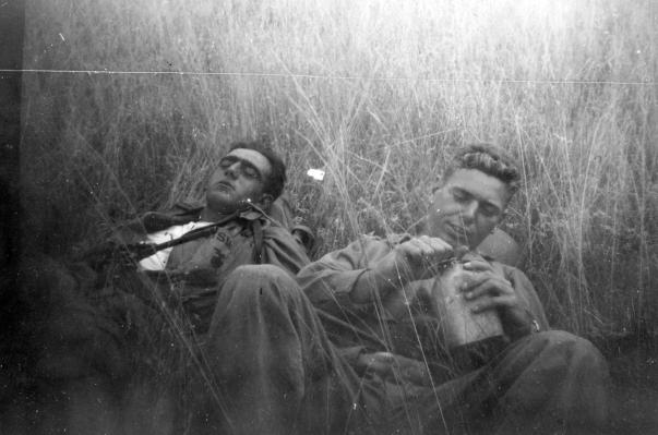 "John ""Blackie"" Poggioli and John Pope take a breather on field exercises at Camp Pendleton."
