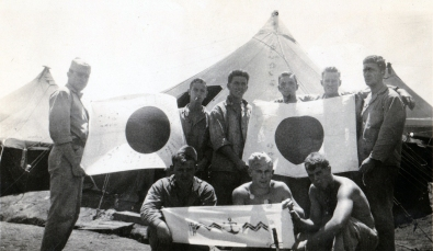 Showing off the spoils of war at Camp Maui, 1944.