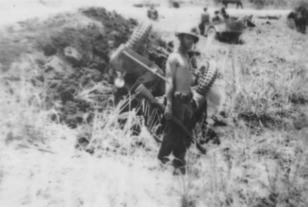 John Pope with capsized truck on Saipan.