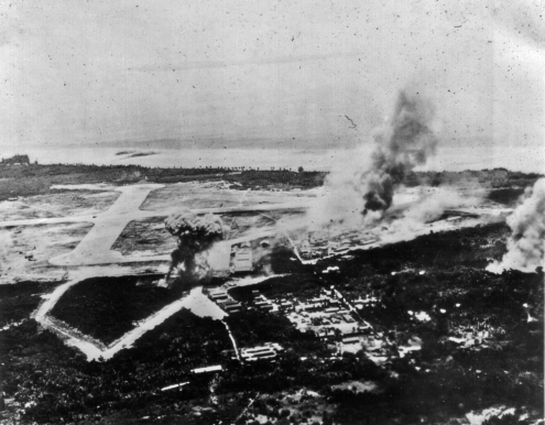Peleliu's airfield comes under aerial attack. The marines landed on the beach in the background.