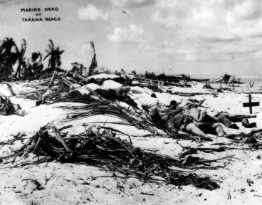 Marine dead on the beach at Tarawa. At least one has been marked with a makeshift cross.