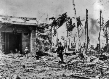 Marines move up to clear a large Japanese structure on Namur.