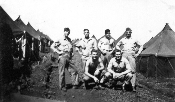 Charlie Company machine gunners at Maui. Sandy Ball is second from left; squatting in front of him is Bill Logan. Henry A. Manzi is standing at right.