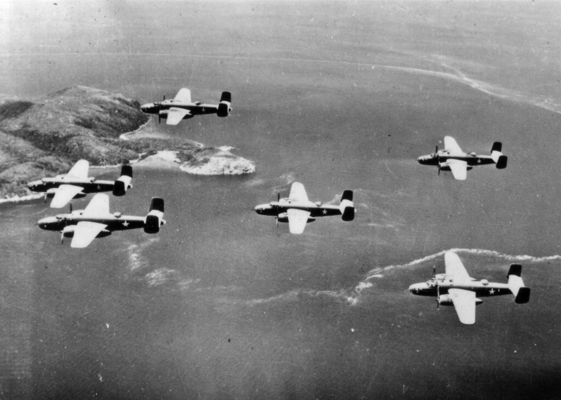Before almost any invasion, the defenses were softened up by air and sea bombardment. Here, a squadron of Marine PBJ Mitchell bombers is en route to a target.