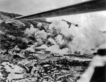Bombs explode on a Japanese-held island.