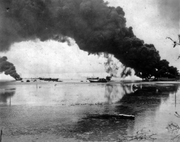 """Jap Fuel Dump Afire. Saipan - Dense black smoke rises thousands of feet in air from Jap fuel dump in blasted Garapan, capital of Saipan, as naval guns lobbed large shells before its capture. Photo by Stanley Troutman, ACME staff photographer for War Picture Pool"