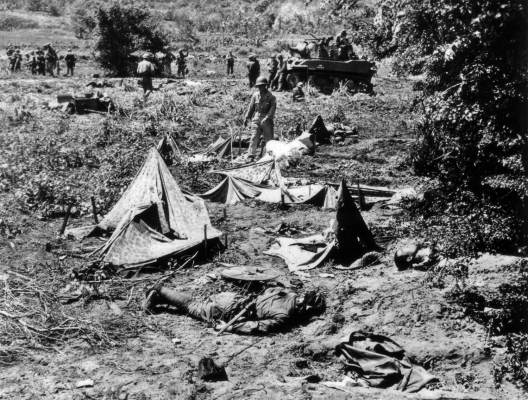 Japanese troops - their mangled bodies in the foreground - attempted to overrun a small marine camp during a nighttime infiltration.