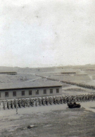 An infantry column marches past the barracks at Camp Pendleton.