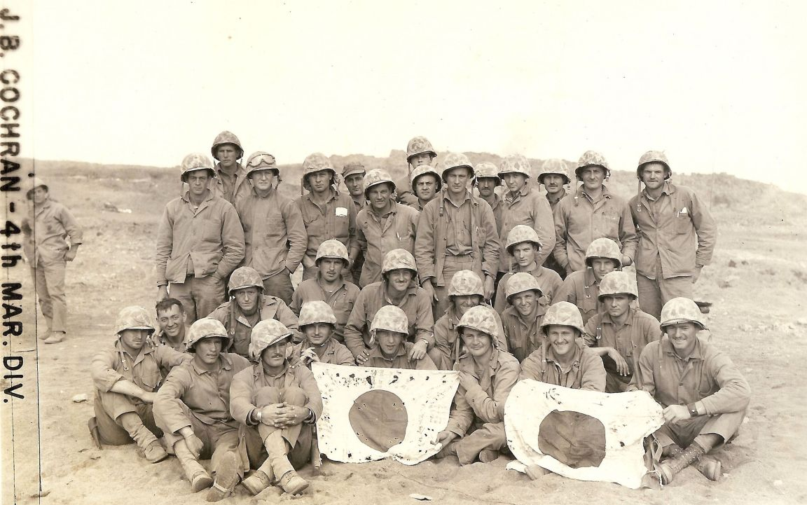 31 survivors of Company C, 24th Marines, after the battle of Iwo Jima. Photo by PFC James Cochran (H&S/24) and provided by Brad Logan