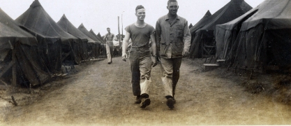 "Buddies GI and ""Butch"" Campbell strolling down the company street. All Marines had at least one close buddy with whom they did nearly everything from liberty call to manning a foxhole."