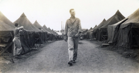 Another Marine, possibly Tom Johnson, in the company street.