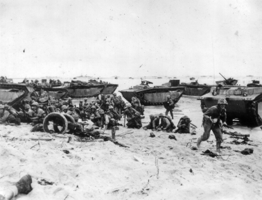 Mass confusion on the Peleliu beaches. Few marines seem willing to leave the protection of the tideline.