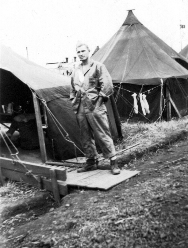 Corporal Ball outside his tent at Camp Maui.
