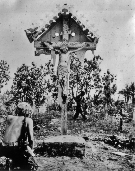 A religious marine takes time out from the slaughter.