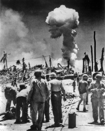 A large explosion raises little interest from the American troops in the foreground.