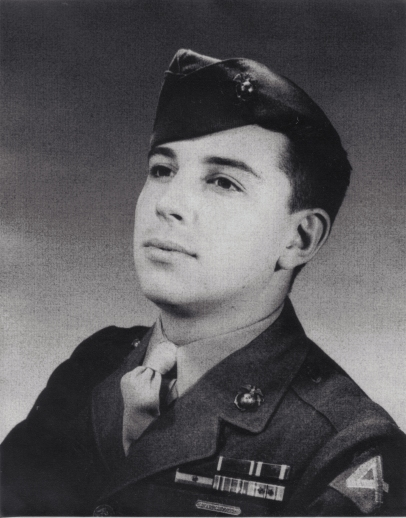 PFC Elissagaray sits for a formal portrait in the fall of 1944. He is wearing his Purple Heart and Commendation Ribbons above his campaign awards.