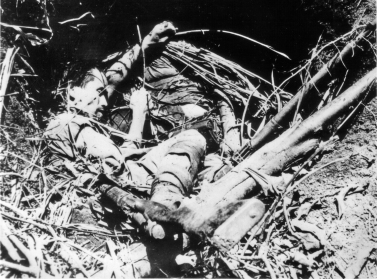 Dead Japanese soldiers in a fighting hole.