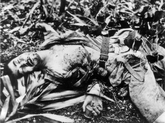 This Japanese soldier was killed with a grenade in his hand. Feigning death and detonating grenades when Americans were nearby was a common tactic; marines learned to shoot any bodies they saw.