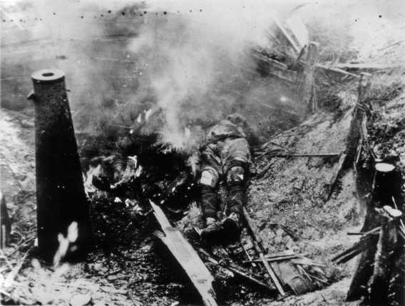 Japanese dead in a prepared fighting position. The pole at center likely supported a heavy automatic weapon.