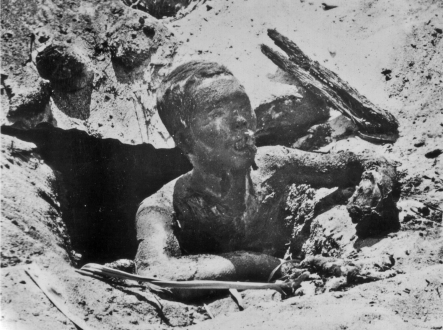 This gruesome picture shows a Japanese soldier who emerged from a spider hole directly into the path of a flamethrower.