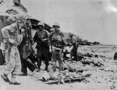 Despite the best efforts of the corpsmen, it seems that the man on the stretcher has died. Note the looks on the faces of the men, and the fact that no medical personnel are attending to the bandaged marine.