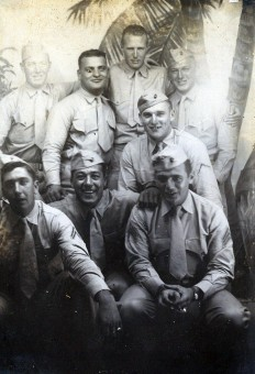 "Veteran machine gunners on liberty. Top row: ""Red,"" Dominick Piccolomini, Bill Peck, Ed DuBeck. Middle: ""Berpley"" Bottom: Joe Peterpaul, Danny Girdano, Joe Devoy"