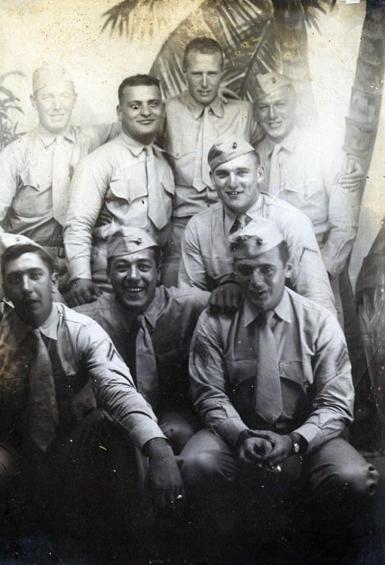"Veteran machine gunners on liberty. Top row: ""Red,"" Dominick Piccolomini, Bill Peck, Ed DuBeck. Middle: ""Berpley"" Bottom: Joe Peterpaul, Danny Girdano, Joe Devoy"