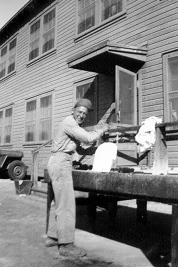 Ed does some washing up. Probably taken at Camp Pendleton, 1943.
