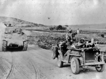 Corpsmen evacuate a pair of badly wounded marines by jeep during the battle of Saipan.