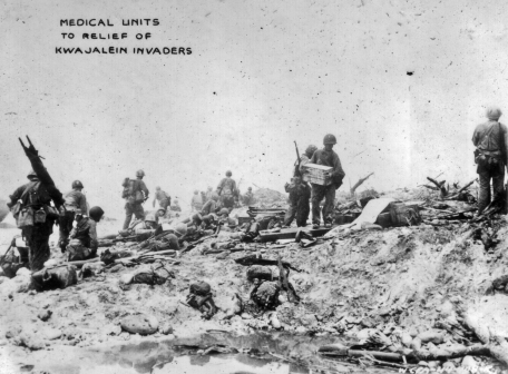 Medical staff move towards the front during the invasion of Kwajalein.