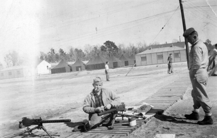 Sandy cleans a .30 caliber Browning machine gun, probably at Camp Lejeune, 1943.