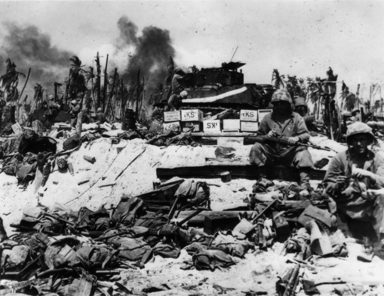 Namur, 1944. A marine assault unit has dropped its packs in a pile on the beach before advancing inland. The two men at right might have been assigned to guard their comrades' belongings.