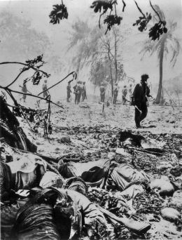 The results of a successful patrol - marines on their feet, and the enemy dead in the foreground.