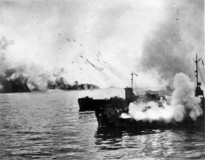 An LST, specially modified to fire rockets, launches a salvo in support of a landing.