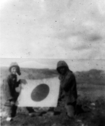 """This picture, simply labeled """"Saipan,"""" is the only known personal photograph of Company A Marines during a campaign."""