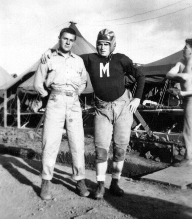 """Sandy (in the football uniform) with one of his platoon mates - and future Marine Corps legend - """"Iron Mike"""" Mervosh."""