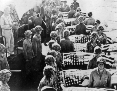 Marines who have died of their wounds are buried at sea from a hospital ship.