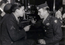 """Bernard in a bar with a friend known as """"Sky"""" - an easy nickname as his patch shows him to be a member of the Glider Airborne Infantry command."""