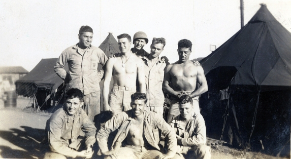 A machine gun squad at Camp Maui. Corporal Doster is at right in the front row.