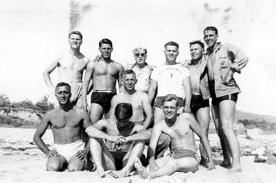 Machine gunners take a liberty break on the beach.