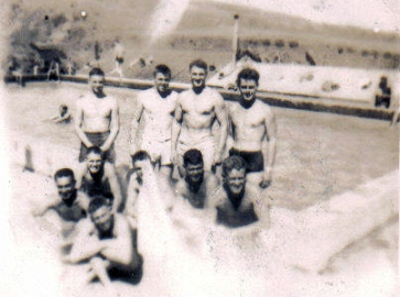 This group of Marines is much happier to be relaxing in the Camp Pendleton pool instead of training in it.
