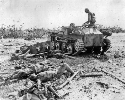 A marine inspects a Japanese tank destroyed during a counterattack across Peleliu's airfield in September, 1944.