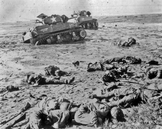These Army tanks, mired in soft ground, came under attack by waves of Japanese infantry.