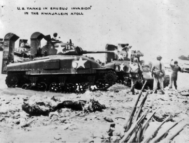 Army tanks support the invasion of one of the tiny islands of Kwajalein atoll.