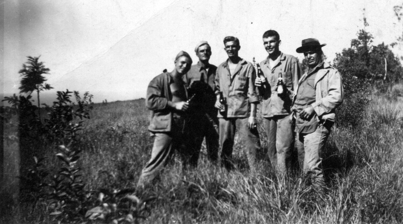 Sandy and friends enjoying captured Japanese beer after the battle of Tinian. From left: Sandy, Sergeant Wilson Cook, Sergeant Charles Czerweic, Sergeant Michael Murray, and PFC Giuseppe Giambone.