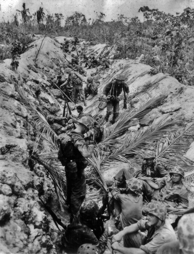 Marines wait for The Word in the safety of a Japanese anti-tank ditch.